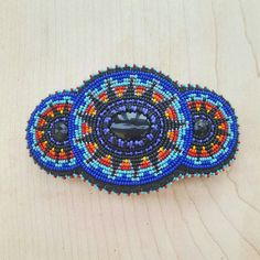 Check out this item in my Etsy shop https://www.etsy.com/listing/270152643/beaded-barrette-rainbow-beaded-hair-clip