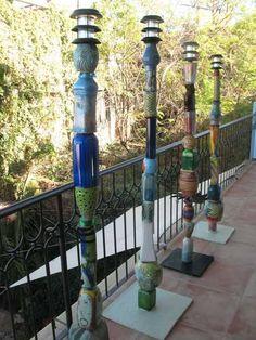 Faroles de cerámica para jardín.