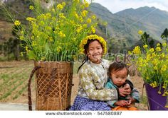 DONG VAN, HA GIANG, VIETNAM, January 01, 2017: Unidentified ethnic minority kids with baskets of rapeseed flower in Hagiang, Vietnam. Hagiang is a northernmost province in Vietnam