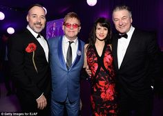 Starry-eyed: Guests at the 22nd Annual Elton John Oscar Viewing Party included Alec and Hilaria Baldwin, shown here with Elton and his husband David Furnish.