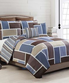 Look what I found on #zulily! Blue & Chocolate Morgan Quilt Set #zulilyfinds. $39.99. Queen. Nice, but polyester.