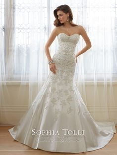 Sophia Tolli - Y11636 – Reine - Strapless sweetheart Paris satin trumpet wedding dress, crystal hand-beaded lace appliqué bodice with dropped waist, back corset, chapel length train. Removable spaghetti and halter straps included. Also available with a back zipper as style Y11636ZB.  Sizes: 0 – 28  Colors: Ivory, White