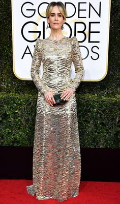 WHO: Sarah Paulson WEAR: Marc Jacobs gold lace-embellished long-sleeve open-back gown with rolling waves of sparkling gold and silver sequins.