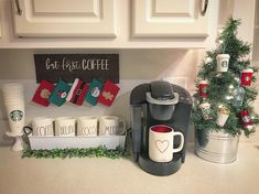 (@home_sweet_homedecor) farmhouse coffee bar Rae Dunn Christmas mugs cocoa coffee station coffee cozy Starbucks ornaments