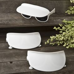 Want to add a fun and frivolous vibe to your pool party? Give each guest a unique sunglass and visor combination to spice up their designer outfits.