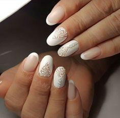 Classic White Studded Nail Art Design. Create your patterns and stud it up using different studs.