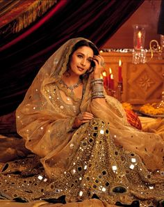 Madhuri Dixit , the first female mega-star of Bollywood , She was famous for her articulate acting and collaborating western dance with Indian classical dance. Madhuri Dixit, Bollywood Stars, Bollywood Fashion, Costume Bollywood, Bollywood Actress, Crepe Satin, Indian Dresses, Indian Outfits, Indian Bridal