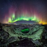 A Stunning View of the Northern Lights over Iceland Reflected in a Volcanic Crater Lake