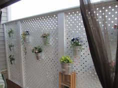 Our Easter project, some buckets from tractor supply filled with some flowers and herbs and hung with s hooks off the lattice