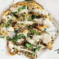 """This Gluten-Free Vegan Roasted Cauliflower """"Steaks"""" with Lemon Dill Tahini Dressing recipe is a healthy, easy recipe made with clean, real food ingredients and needs only about 5 minutes prep time. { The Healthy Family and Home } Lemon Dill Dressing Recipe, Lemon Dill Sauce, Sauce Recipes, Real Food Recipes, Free Recipes, Vegan Recipes, Roasted Cauliflower Steaks, Vegan Roast, Vegan Gluten Free"""