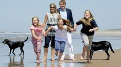 Queen Máxima, King Willem-Alexander and their three daughters Princess Amalia, Princess Alexia and Princess Ariane kick off their shoes and take a walk along the shoreline on the Beach in Meijendel during their annual summer photocall, on Friday.
