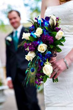 We loved this peacock-inspired bridal bouquet at Tapestry House! Florals by Bes… We loved this peacock-inspired bridal bouquet at Tapestry House! Florals by Best Day Floral Design. Photo by Tom K. Cascading Bridal Bouquets, Bride Bouquets, Flower Bouquet Wedding, Floral Bouquets, Peacock Wedding Flowers, Bride Flowers, Peacock Themed Wedding, Blue Orchid Bouquet, Purple Wedding