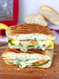 Chicken Pesto Peach Panini - The perfect summer panini filled with pesto, sweet peaches, juicy chicken and lots of melting cheese. Fresh, fabulous and so full of flavor!