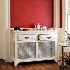 Stylish Radiator Cover Ideas For Summer | Domino -- Sideboard or radiator cover? You decide. This classically elegant guise is perfect for the dining room to keep cutlery and dinnerware close and at-hand.