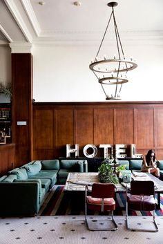 green sectional | wood paneling | Ace Hotel Portland