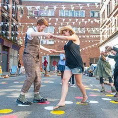 """Game designer Holly Gramazio helped create""""Scotch Hoppers""""for Glasgow in 2014. With some polka dots and festive accoutrements, these streets reach people's inner-child, inviting them to come out and play! #Placemaking #LQC #StreetsAsPlaces #Paint"""