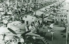 curtis wright buffalo ny wwii women workers | More P-40 Warhawks near completion in Buffalo, New York. The ...
