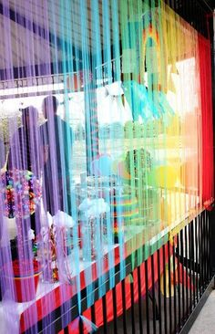 Tulle backdrop at a Rainbow Party #rainbow #partybackdrop
