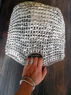 By VMSomⒶ KOPPA.   My friend has one of these bags made from tin can ring pulls. Neat recycling and makes great chain mail material, you know, like old suits of armour. Cool bag, I want one!