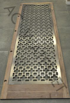 Door Design - Waterjet Cut 1/4 inch thk Aluminum Anodized Champagne both sides.