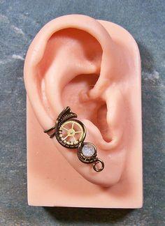 Vintage Bronze & Aquamarine Small Steampunk Ear Cuff. $11.99, via Etsy.
