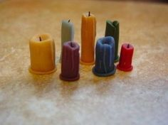Make tiny drippy candles like the one's seen here, in Witch Hilda's Cottage.  More free miniature dollhouse projects at My Small Obsession, click the link at the bottom of this page.  You will also find a video tutorial near the bottom of this page....