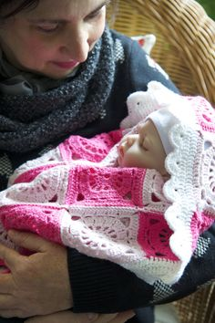 """""""Rose Garden"""" is a handmade crocheted baby blanket. The Ultra Soft Merino mix (50% virgin wool, 50% polyamide) is especially made to embrace babies."""