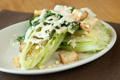 Mesquite Grilled Caesar Salad! Simple & the WOW factor! Romaine Hearts kissed on the grille, drizzled with Caesar dressing and homemade crunchy croutons.