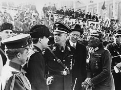 German Foreign Minister Joachim von Ribbentrop talking to Italian and Japanese guests during a parade in Vienna right Franz von Papen 1938 Vintage...