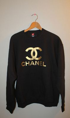 Gold de Chanel black sweater.