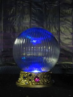 Crystal ball made using a ceiling light, puffy paint, spray paint, and gems.  Add a color changing light beneath ~ Magical