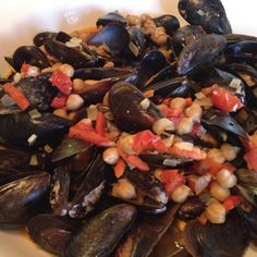 Spanish mussels with garbanzo beans, pimiento, cherry tomatoes, garlic, onion and a pinch of saffron...YUM!