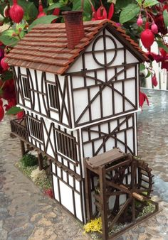This lovely, characterful, 1/48 scale Tudor water mill, is made from strong, box board and MDF with wooden dowels. The roof tiles, over 370 of them! Are real, weathered brick, every one hand applied. The mill has 4 rooms with fixed doors and the interior ladder/steps have not been fixed in place to aid easy access for decorating. Carpets are fixed. Three back walls lift out for easy access. With scatter decoration. Tiles have been sealed with matte varnish. Suitable for dolls house, O scale…