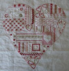 a sampler heart filled with sweet stitches