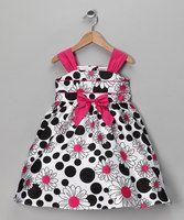 A splash of fuchsia, a sweet bow and a twirly tie at the waist give this pretty dress extra-darling appeal. Pair it with ballet flats for poise that's perfect for any party princess.65% polyester / 35% cottonMachine wash; tumble dryImported