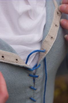 If you do an apron with a slit up the side, use this technique for the bodice laces on either side.