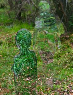 Rob Mulholland - sculptures out of mirrored Perspex (or acrylic glass).  Mulholland has previously installed these chameleon-like figures in the woods around Alloa, Loch Ard and the David Marshall Lodge in Scotland.