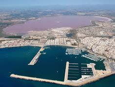 Salina de Torrevieja, Spain: Salina de Torrevieja and La Salina de La Mata are salt lakes that surrounds Torrevieja - a seaside city in south-eastern Spain. The microclimate formed by La Salina de Torrevieja and La Salina de La Mata, both the biggest saltlakes in Europe, is declared one of the healthiest of Europe by the WHO - World Health Organisation.
