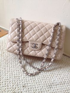 AUTHENTIC CHANEL JUMBO BEIGE CAVIAR 255 FLAP HANDBAG WITH SILVER HARDWARE.  VERY GOOD VINTAGE CONDITION Contact me for additional information or photos.at cookie88@comcast.net