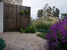 Eco Outdoor porphyry filetti courtyard, Michael Cooke Garden Design, installed by Nature's Vision Landscapes   Eco Outdoor   porphyry filetti    livelifeoutdoors   Outdoor Design   Natural stone flooring   Garden design   Outdoor paving   Outdoor design inspiration   Outdoor style   Outdoor ideas   Luxury homes   Paving ideas   Garden ideas   Natural stone paving   Floor tiles   Outdoor tiles   Courtyard design   Stone path