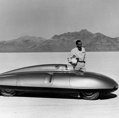 In 1957 the MG Car Company arrived at the Bonneville Salt Flats with a vehicle and a legendary racing driver , Stirling Moss. The MG EX 181