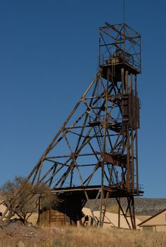 The skeletal remains of the Denn shaft headframe. The toplander's deck and ore bins have been removed.