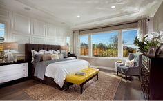 Privately located and overlooking the serene backyard setting, the master suite boasts dual sinks, a soaking tub and an expansive walk-in closet. - Residence One at Cabrillo at Verdera in Lincoln, CA