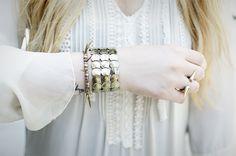 Nicole Alyse of RUNNING IN WEDGES wearing MS metal circle stretch bracelet.