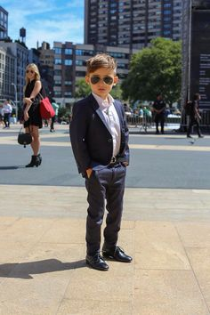 Kids in navy blue suit so stylish looks like a real man