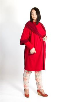 "Straight hooded coat in contrasting cherry and red colors featuring a wide hood which switches to a ""scarfy"" collar, an open front or may be belted waist, 3/4 sleeves, one patch pocket and a mid-length."