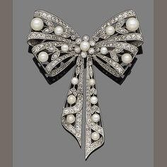 Belle époque pearl and diamond bow brooch, circa 1900. Love the simplicity of this design!.