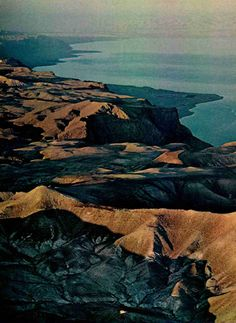 Beyond Judaean hills sloping to the northeastern shore of the Dead Sea, rising vapors veil the mountains of Biblical Moah in Jordan, National Geographic, February 1978