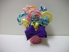 Click here for more lollipop bouquets and  by EdibleWeddings on Etsy, $24.99. Multi arrangements! Easter Lollipop Arrangement Girl. Multi color, green, blue, yellow, orange, pink, purple, polka dots, bunny lollipops, Easter, spring, candy, lollipops, custom