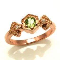 Rose Gold Peridot Hexagon Ring with Diamond Petal Leafs - 14k Rose Gold    This cute little ring has a .28 carat peridot set into a